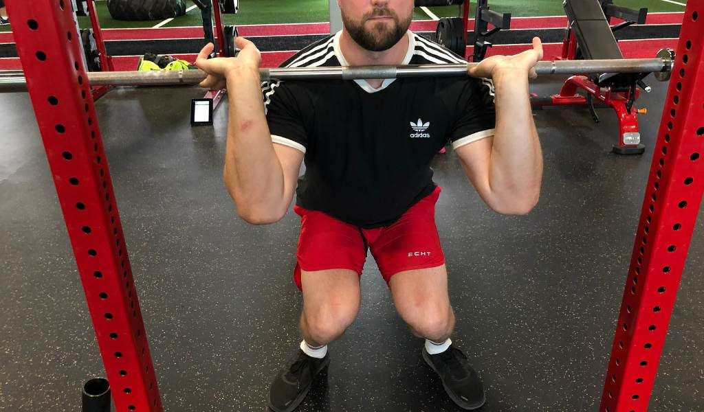 Knees caving in the squat