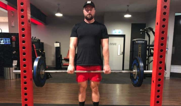 Lock your hips and knees at the same time at the top of a deficit deadlift