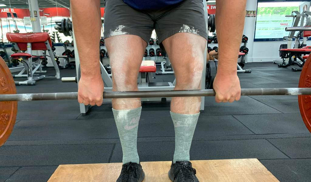 Baby powder on legs reduces the friction of barbell