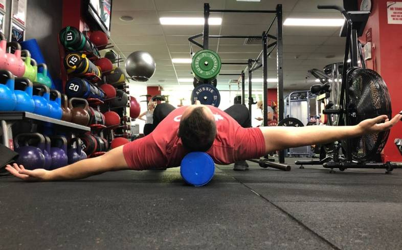 Test your shoulder flexion mobility to diagnose your uneven bench press
