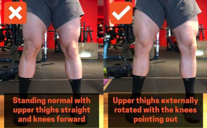 squat cue externally rotate femurs