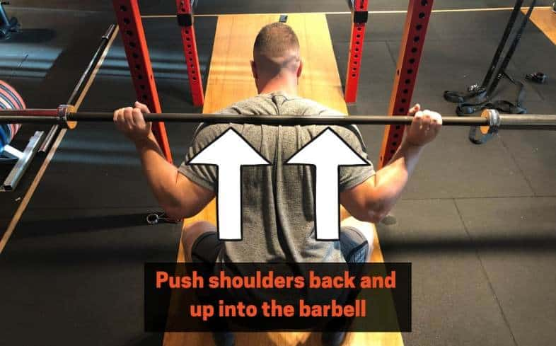 squat cue drive your shoulders back and up into the barbell