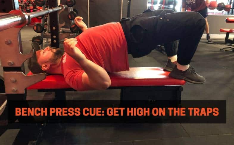 Bench press cue showing getting high on the traps