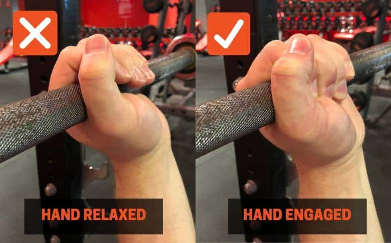 Bench press cue showing one hand relaxed and one hand squeezing strong on the barbell