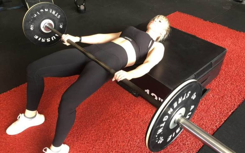 The hip thrust is where you drive your hips up with the load on the crease of your hips.
