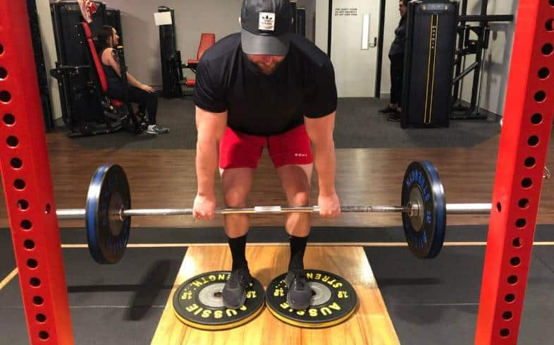 The deficit deadlift is where you stand on plates in the start position to create additional range of motion.