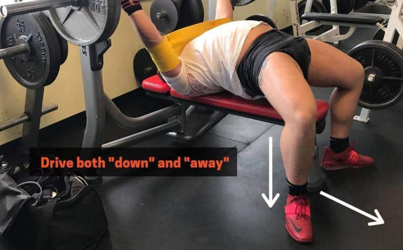 Arrows showing that you should press down and away from you when bench pressing