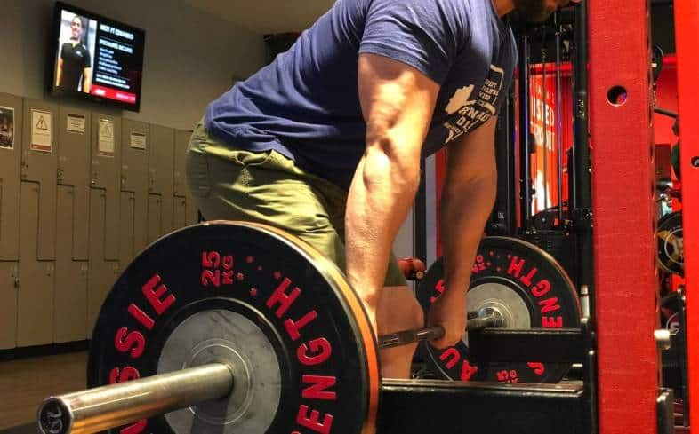 The rack deadlift starts on the rack to focus on the lock-out