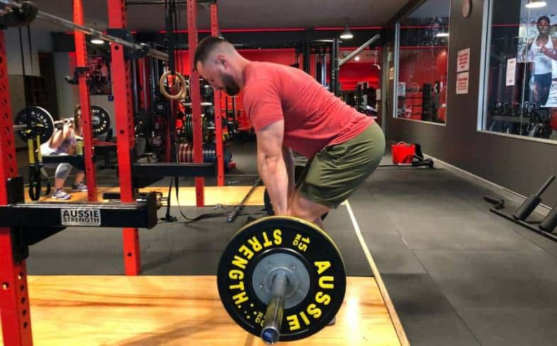 Romanian deadlift is where you start from the top position and lower to the knee before squeezing the glutes and returning to standing.