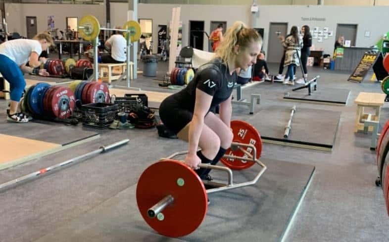 Using a trap bar deadlift with the hands outside the shins