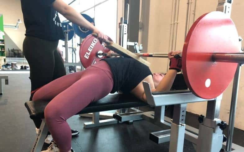 Training the top end range of motion using the board bench press