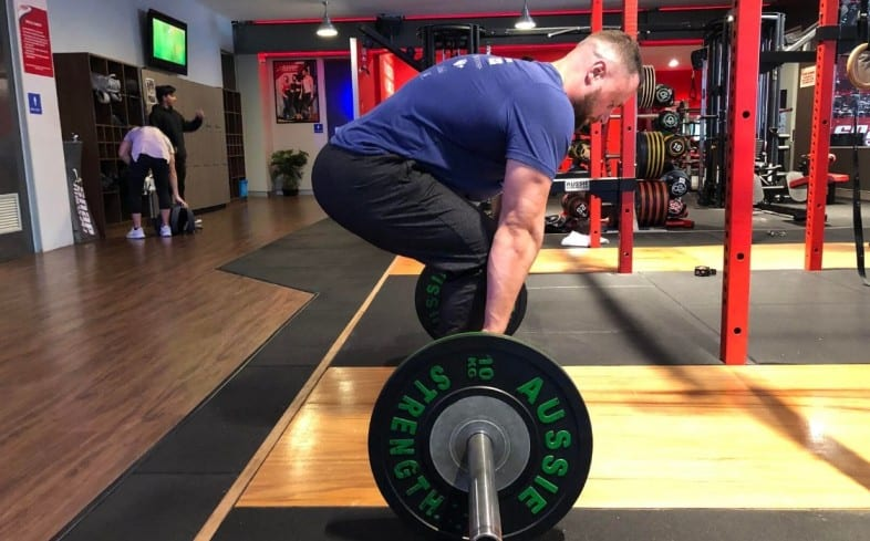 deadlifting with short arms may cause slightly round upper back
