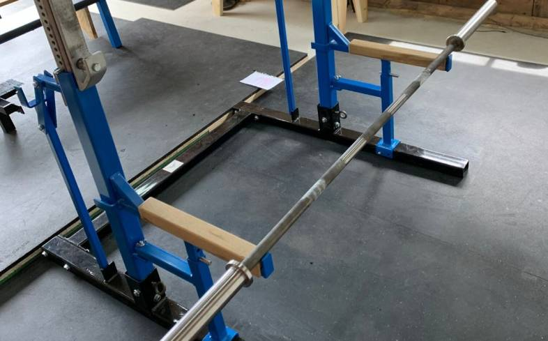 need a squat cage to be able to grab the barbell while you lay on the floor