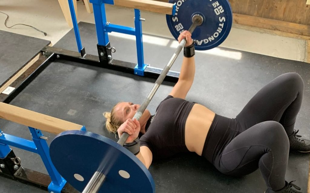 keep your chest high and have your elbows slightly tucking in front of the barbell when lowering the barbell