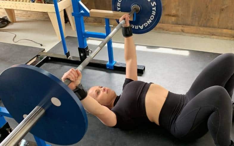 do the floor press with your legs bent and your feet flat on the floor