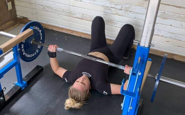 floor press is one of the best bench press accessories used by both bodybuilders and powerlifters for building strength, hypertrophy, and technique
