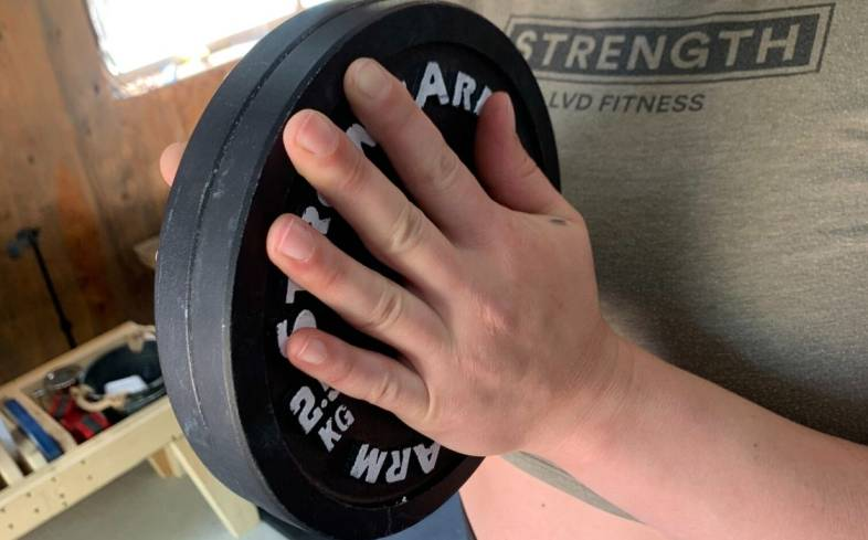 start by using two 10lb plates and squeezing them together with your palms