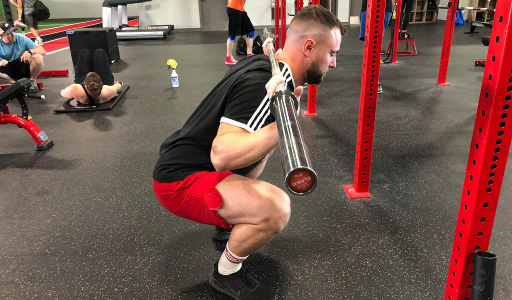 pause squats is an effective way to build tension in the bottom of the squat is to implement exercises that increase the time under tension