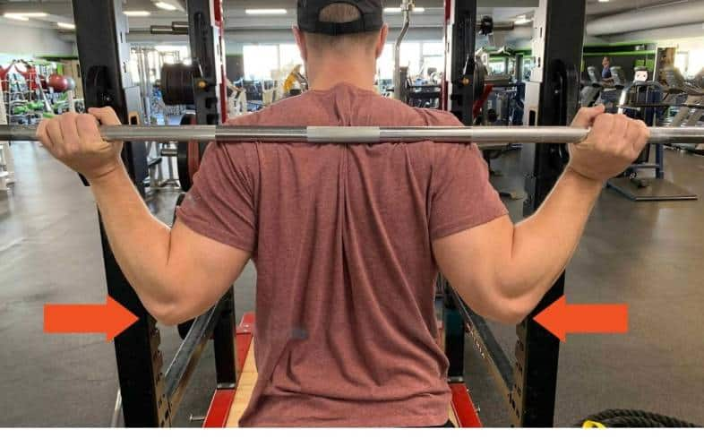 most common reason why people get elbow pain while low bar squatting