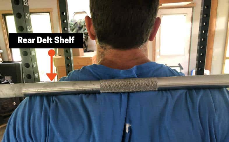 rear delt shelf is a natural place for the barbell to sit for the low bar squat