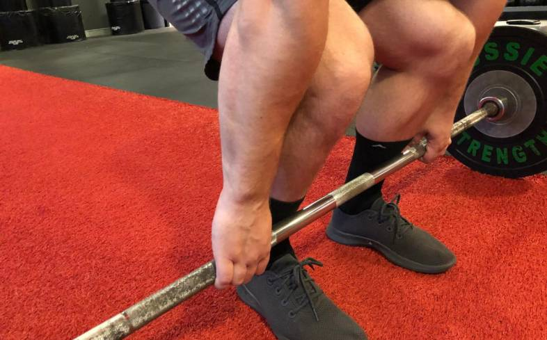 if your stance is too wide then you will be pulling the barbell extra distance