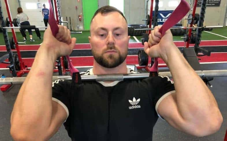 front squat with straps or strap assisted front squats is a way of executing the front squat popularised by bodybuilders and powerlifters