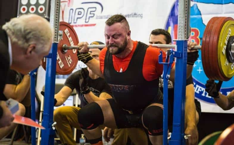 these lifters do not squat with a rounded back in training, and they make every effort to maintain neutral alignment of their spine