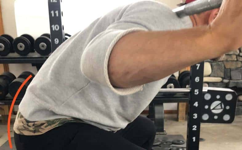 the low back rounding in the squat looks like the hips tucking underneath of you causing excessive lumbar flexion