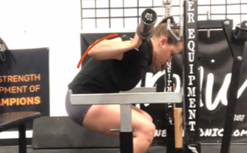 the mid-back rounding in the squat looks like the middle of your back curled forward