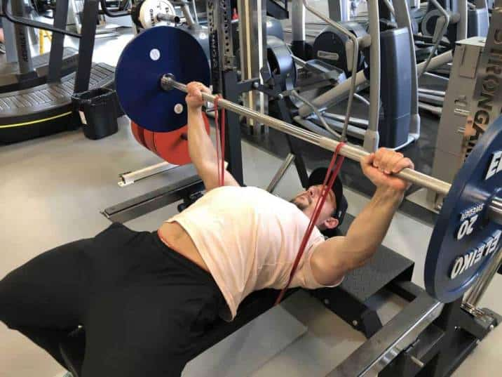 banded bench press is a great exercise for teaching lifters how to accelerate the barbell through the entire range of motion