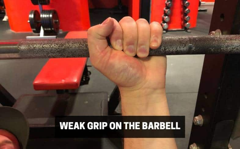 a weak grip on the barbell can lead to your arms shaking
