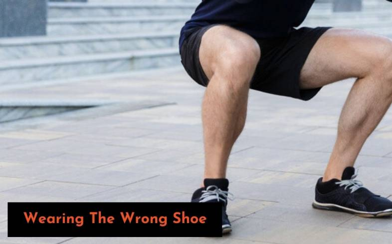 Wearing the wrong shoe can cause your heels to rise in the squat