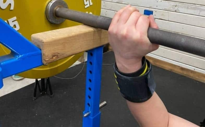 Set the pin or rack for the dead bench press