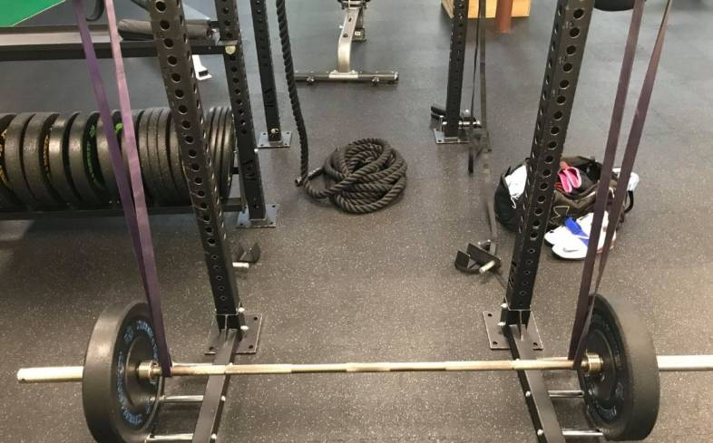 steps on how to set up the reverse band deadlift