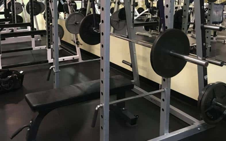 place the bench on the inside the four posts of the power rack