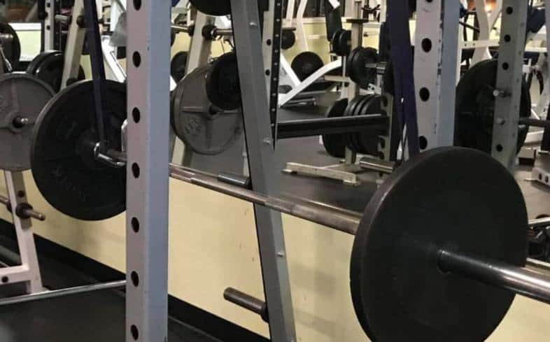 place the bottom of the band around the bottom of the barbell