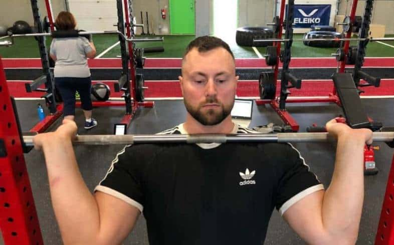 widening your hands and grabbing the bar with 2-3 fingers wrapped under the barbell