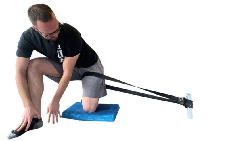 lateral capsule stretch using a heavy resistance band