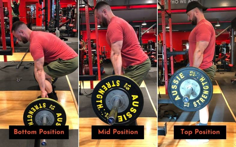 ensure that the shins are vertical when the bar reaches the knees