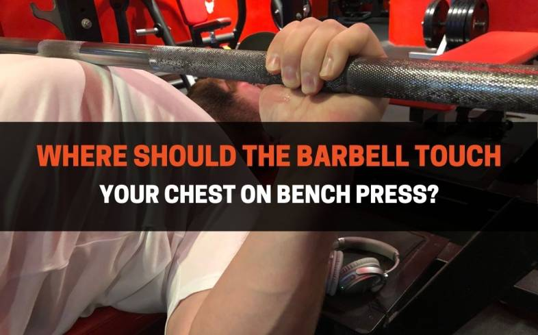 the barbell should touch on the area between the lower pec muscles and the lower sternum during the bench press