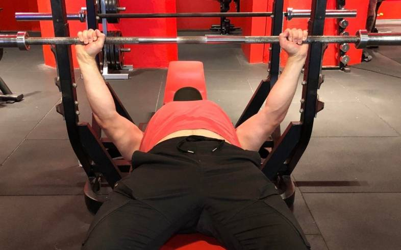 externally rotate the arms to lock in the elbows