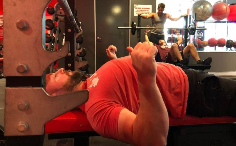 retracting the shoulder blades is a crucial step when setting up the bench press