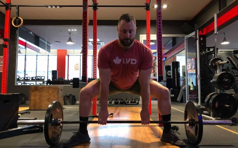 the best sumo deadlift position for each lifter is the stance at which shins are vertical