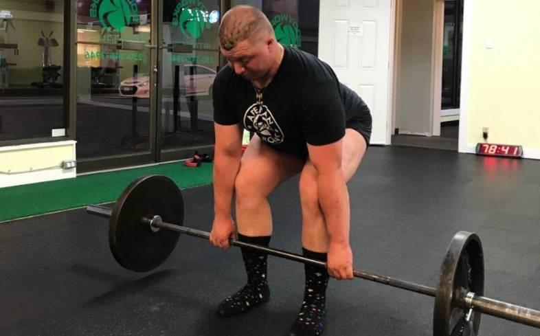 the paused deadlift is done by pausing momentarily at about 1 inch off the floor