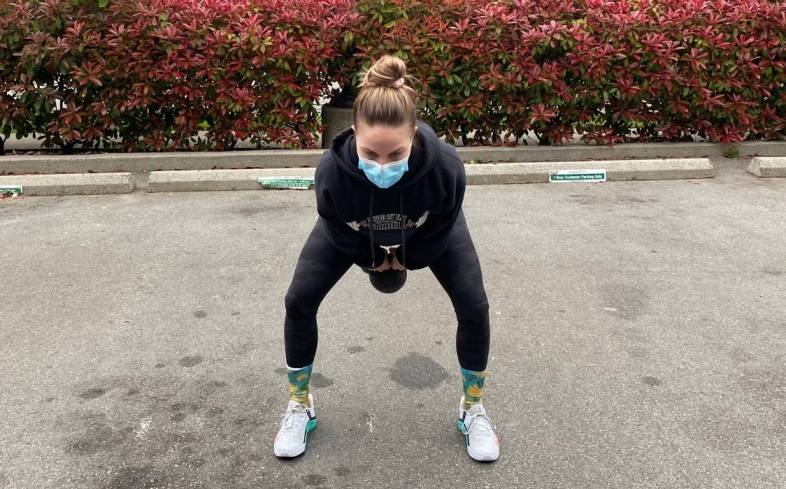 pros and cons of 2 arm kettlebell swing