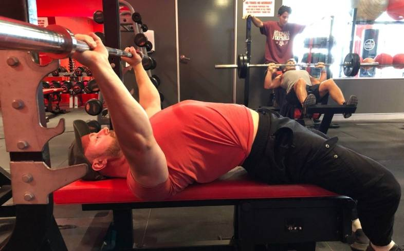 the medium grip bench press is a strong choice to prioritize tucking of the elbows and tricep engagement
