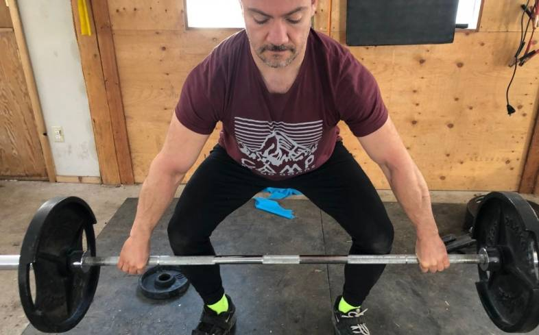 the snatch grip means that you hold the bar at a wider grip