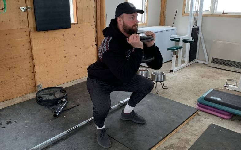 goblet squats are an easier variation and use a dumbbell