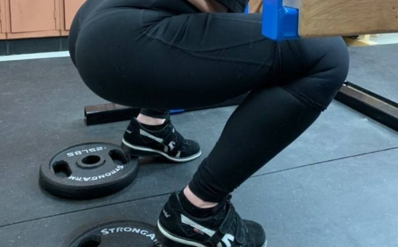 elevating your heels with plates shifts your centre of balance and requires less mobility to achieve squat depth