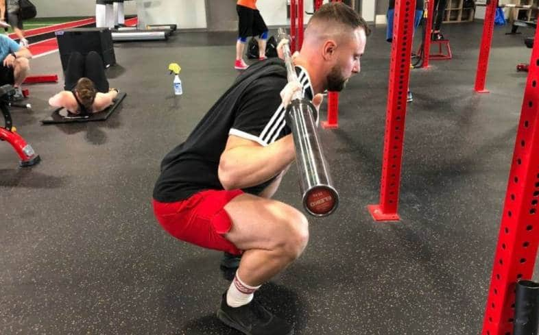 the pause squat is set up exactly the same as the squat, except you will pause for 2-seconds at the bottom range of motion